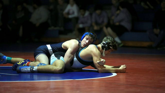 Asheville School senior Conor Fenn has committed to wrestle in college for Davidson.