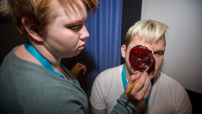 14-year-old Kyra Christopherson-Teubert turns Zachery Brown into a zombie at the Las Cruces International Film Festival's Make-up and Special Effects workshop at NMSU's CMI Theatre on March 5, 2016.
