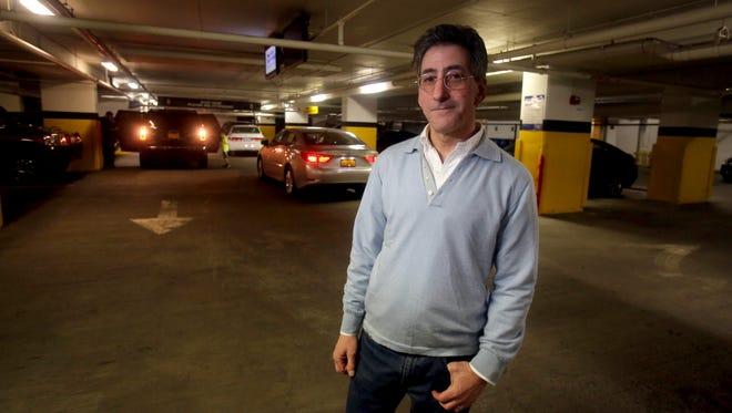 Bruce Feldman, a resident of the Trump Tower condominium in White Plains, in the building's underground parking garage.