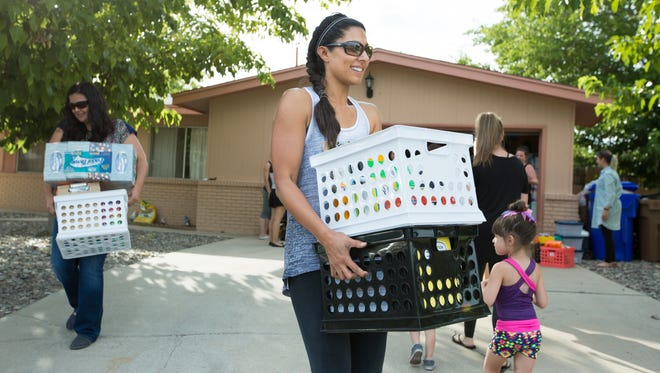 Fairacres third grade teacher Desiree Gutierrez, right, receives school supplies from Las Cruces Moms Tuesday August 2, 2016. Las Cruces Moms fundraised more than $5,500 with their annual Mix & Mingle event giving away school supplies to teachers for their classrooms.