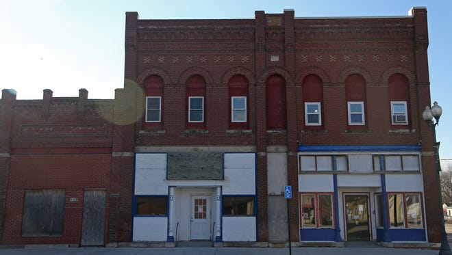 The Bricker Price Building in downtown Earlham on Sunday afternoon, Jan. 29, 2017. Members of the community are in the process of renovating the buildings and creating a social space for the town.