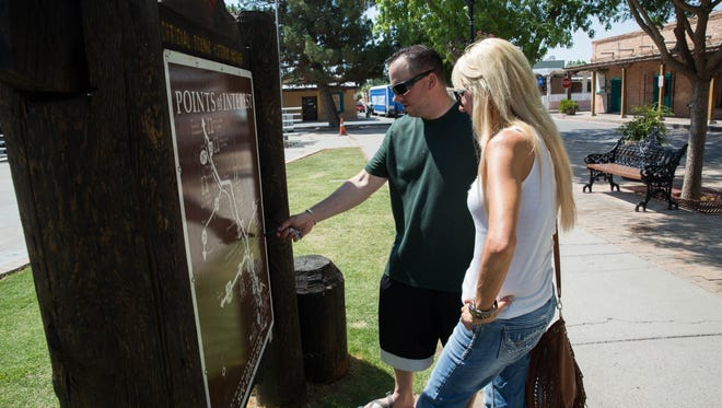 "Cody Drake, left and Kim Maney, look over a map on the Mesilla Plaza Wednesday, July 5, 2017. Drake and Maney stopped by Mesilla on their way back to Arizona after the holiday weekend. New Mexico Gov. Susana Martinez on Wednesday unveiled ""record-breaking"" state tourism figures."
