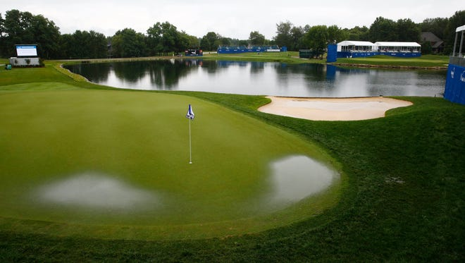 Water builds up on the greens at Keene Trace Golf Club during a weather delay Sunday at the PGA Tour's Barbasol Championship.