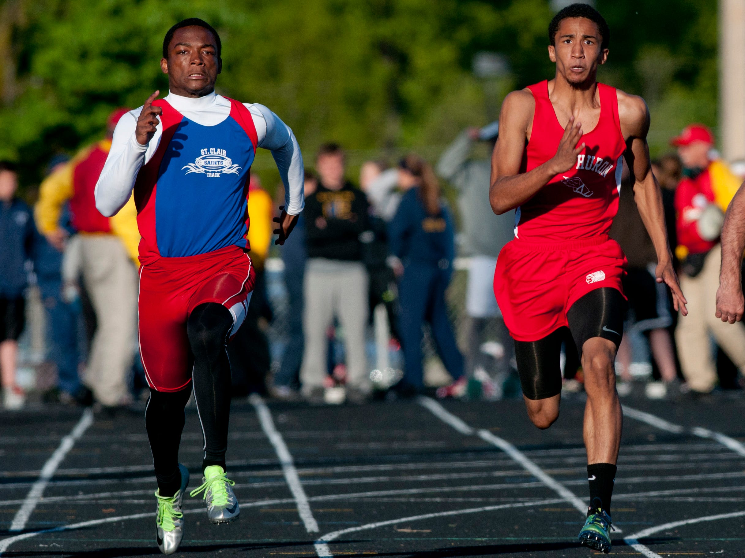 St. Clair sophomore Cameron Williams and Port Huron senior Nick Pierce compete in the 100-meter dash during the Meet of Champions Friday, May 22, 2015 at Marysville High School.