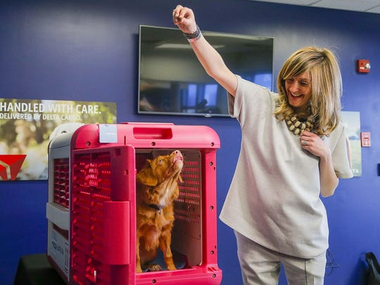 Delta Cargo lead product manager Sara Bernhardt and her 5-month-old Nova Scotia duck tolling retriever, Peach, introduce the CarePod.