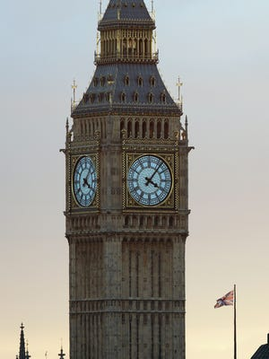 A Union flag flies from a flagpole near to the Elizabeth Tower, also known as Big Ben, at the Houses of Parliament in central London/