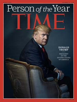 This image provided by Time magazine shows the cover of the magazine's Person of the Year edition with President-elect Donald Trump in New York.
