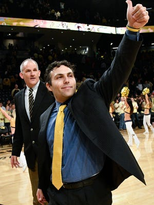 Georgia Tech head coach Josh Pastner gestures to fans as he and assistant coach Eric Reveno leave the court after an NCAA basketball game against Florida State, Wednesday, Jan. 25, 2017, in Atlanta. Georgia Tech won 78-56.