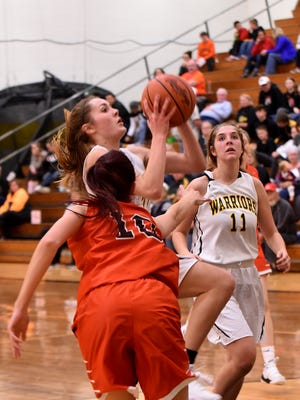 Watkins Memorial junior Taylor Looney goes up for a layup during a game earlier this season. The Warriors sit in first place after a thrilling victory Jan. 9 against rival Licking Heights.