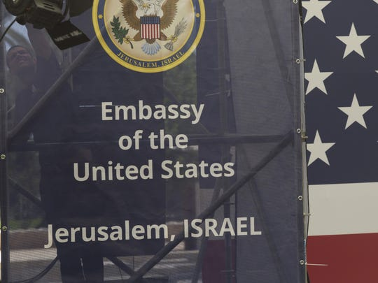 Israeli workers prepare the ceremony stage inside the US consulate that will act as the new US embassy in May 13, 2018 in Jerusalem, Israel.