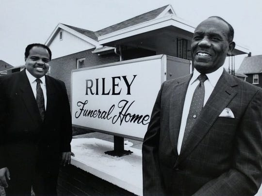 James Riley Jr., left, and his father, James Riley Sr., in front of their funeral home at 426 W. St. Joseph St. on May 22, 1990.