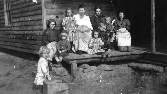 The Ruff family, pictured on their porch in 1917.