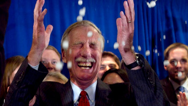 Independent Angus King celebrates under a splash of champagne after winning the Senate seat vacated by Olympia Snowe, R-Maine, Nov. 6, 2012, in Freeport, Maine.