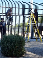 Volunteers paint a skate park fence in Goodyear for Make A Difference Day in 2013.