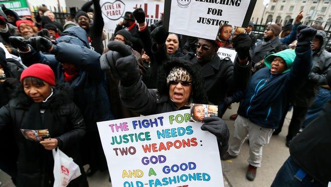 Renla Session, center, chants during a protest in Detroit  Nov. 25 in response to the Ferguson grand jury decision not to indict police officer Darren Wilson in the death of Michael Brown.