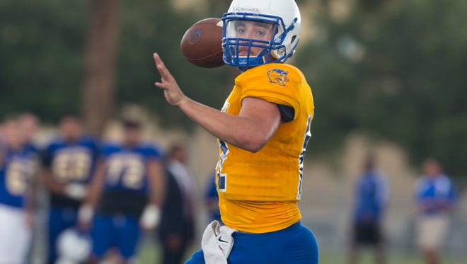 Texas A&M Kingsville's quarterback Cade Dyal throws the ball during the annual spring game at Javelina Stadium on Saturday, April 22, 2017.