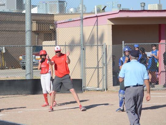 Loving coach Jordan McIlroy argues a call as first