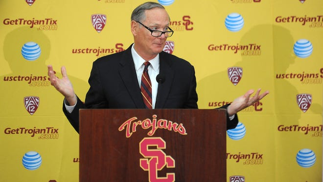 Southern California athletic director Pat Haden speaks with the media during a press conference after an NCAA college football practice in Los Angeles.