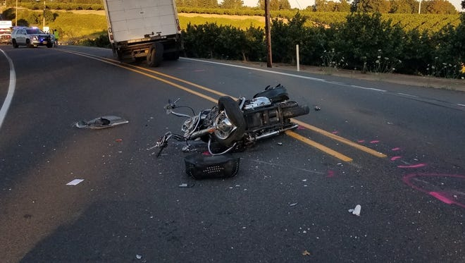A 75-year-old man died after his motorcycle collided with a semi-truck Thursday evening.