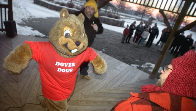 Dover Doug greets residents who came out to hear his Groundhog Day predictions.