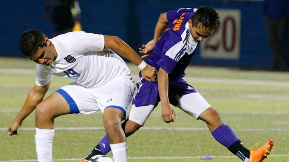 An unidentified eastlake player attempts to get control of the ball against Brownsville Porter's Fernando Trigo during action in their semi-final game of the UIL State Soccer Championships played at Birkelbach Field in Georgetown, Texas. eastlake would see their season end with a 4-1 loss Thursday night.