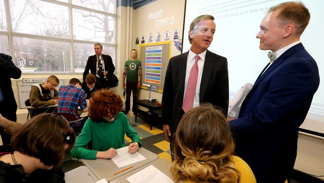 Tennessee Governor Bill Haslam left talks with Central Magnet High School Algebra II teacher Kyle Prince, in Prince's classroom, on Wednesday, Jan. 25, 2017.