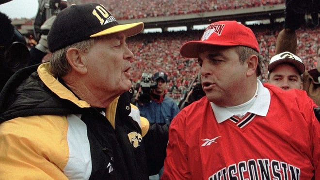 Wisconsin coach Barry Alvarez  is congratulated by his mentor,  Iowa coach Hayden Fry, after the Badgers upset the Hawkeyes, 13-10, in 1997 at Camp Randall Stadium. The victory broke UW's 18-game winless streak against Iowa.