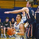 White House High senior point guard Luke Hopkins penetrates into the lane as White House Heritage junior Tyler Welborn defends. Hopkins scored 11 points in the Blue Devils' 79-78 loss on Thursday evening.