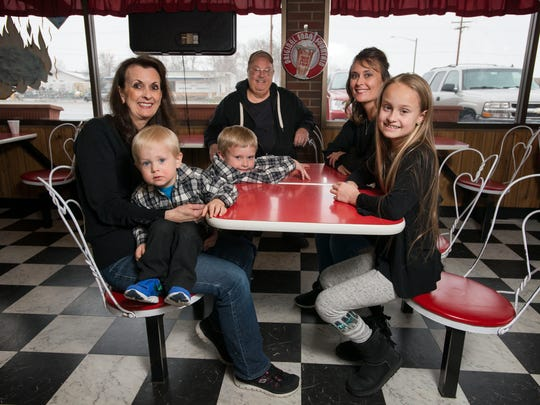 From left, Owner and operator Pat and Mike Embke, left and center, pose for a portrait with their daughter and office manager Christie Bradford and grandchildren, from left,  Michael, Mill and Bella, on Friday, April 6, 2018, at the Dairy Delite ice cream shop in Loveland, Colo.