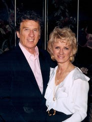 Mike Ilitch and Marian Ilitch pose in an undated photo.