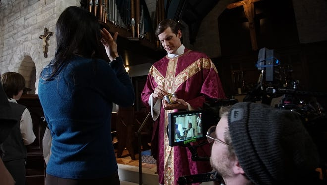 """The Good Catholic"" star Zachary Spicer prepares for a scene at Trinity Episcopal Church in Bloomington."