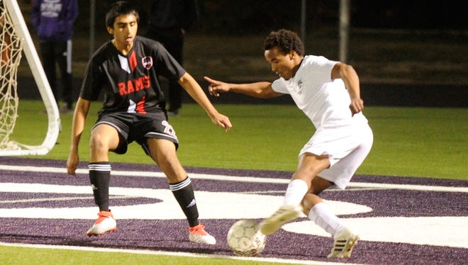 Wylie midfielder Josiah Tuegel (12) makes a play against a Mineral Wells defender during the Bulldogs' 1-0 victory at Bulldog Stadium on Tuesday, March 6, 2018.