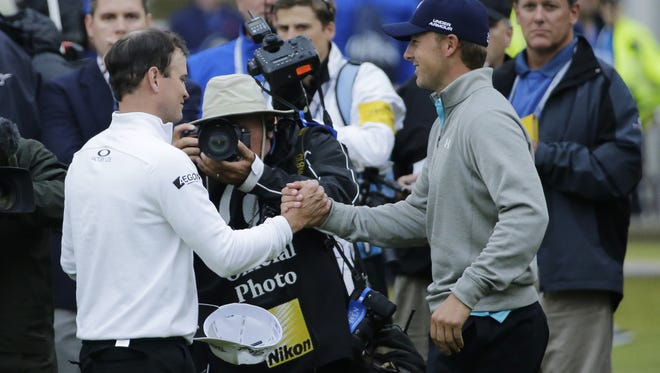 Zach Johnson, left, is congratulated by Jordan Spieth, after Johnson won the British Open to end Spieth's run of two straight major victories in 2015. The four major championships will be part of the story lines for the tour for 2016. Zach Johnson, left, is congratulated by Jordan Spieth after winning a playoff after the final round of the British Open on July 20. United States' Zach Johnson, left, is congratulated by United States' Jordan Spieth after winning a playoff after the final round of the British Open Golf Championship at the Old Course, St. Andrews, Scotland, Monday, July 20, 2015. (AP Photo/David J. Phillip)