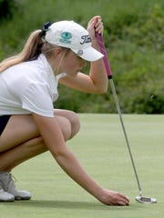 Caroline Hodge of Ursuline places her ball on the 15th green during the Section 1 girls golf tournament at Whippoorwill Country Club in Armonk Wednesday, May 24, 2017.