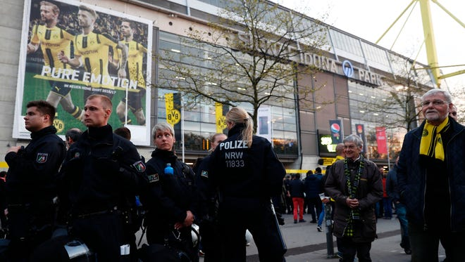 Police patrol outide the stadium after the team bus of Borussia Dortmund had some windows broken by an explosion some 10km away from the stadium prior to the UEFA Champions League 1st leg quarter-final football match BVB Borussia Dortmund v Monaco in Dortmund, western Germany on April 11, 2017. / AFP PHOTO / Odd ANDERSEN        (Photo credit should read ODD ANDERSEN/AFP/Getty Images)