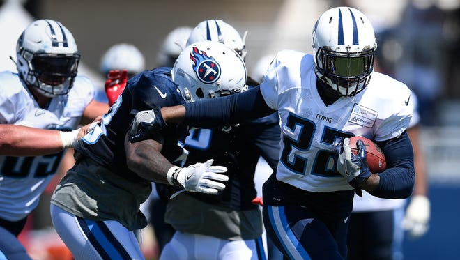 Titans running back Derrick Henry (22) rushes past the defense during training camp practice at Saint Thomas Sports Park Monday, July 31, 2017 in Nashville, Tenn.