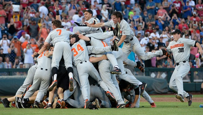 Jun 28, 2018; Omaha, NE, USA; The Oregon State Beavers celebrate after game three of the championship series of the College World Series against the Arkansas Razorbacks at TD Ameritrade Park. Mandatory Credit: Steven Branscombe-USA TODAY Sports