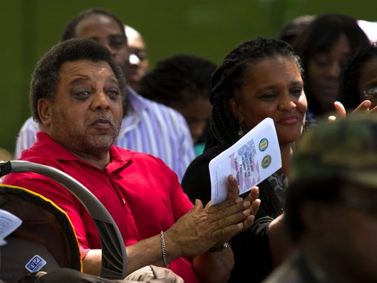 Mickey Rowe, brother of Sp4 Arelinn Jackson, listens to a dedication speech by the Vietnam Veterans of America on Sunday, at Oak Ridge Cemetery in Fort Myers.