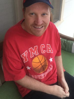 Rodney Clay, shown wearing a YMCA t-shirt, has worked for San Angelo's YMCA for 21 years.