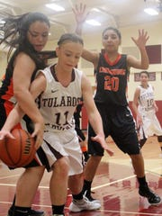 Tularosa's Shania Gililland tries to grab a loose ball while being defended by two Lordsburg players.