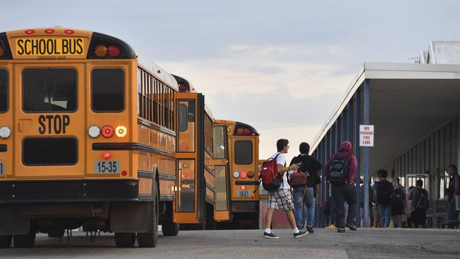Students are seen in 2019 on the first day of the academic year in the Warren Local School District in Ohio.