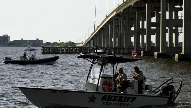 Lee County Sheriff's Office and local law Law enforcement search for a drowning victim under the Calossahatchee bridge in Fort Myers Sunday evening.