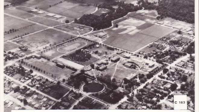 SLI from the air An aerial view of Southwest Louisiana Institute in 1937. The wooded area is Girard Park; in the upper left is Heymann property.