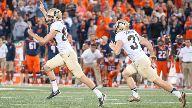 Purdue punter Joe Schopper (31) and place kicker J.D. Dellinger (85) celebrate Dillinger's game winning overtime field goal during an NCAA college football game against Illinois Saturday, Oct. 8, 2016, in Champaign, Ill.  Purdue defeated Illinois 34-31 in overtime.  (AP Photo/Bradley Leeb)