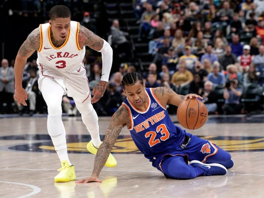 New York Knicks guard Trey Burke (23) goes the the