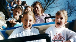 Jessica Logan, left, 10, and Kathryn Logan, 6, both of Nashville, scream with delight on the Rocking Roller Coaster at Opryland theme park. The park opened for it 20th anniversary season March 31, 1991.