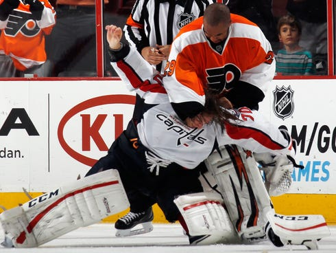 Ray Emery of the Philadelphia Flyers fights with Braden Holtby of the Washington Capitals during the third period at the Wells Fargo Center.