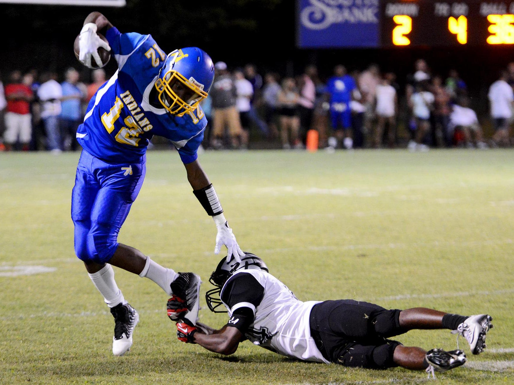 North Side High School's Dexter Pirtle avoids a trip by South Sdie's Shontarrius Word during their game at the 2015 Sports PLUS Jamboree, Friday.