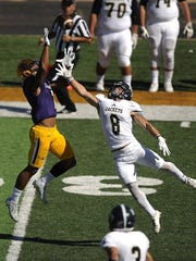 Thomas Metthe/Reporter-News Hardin-Simmons wide receiver Alex Bell (7) goes up for a pass over Howard Payne cornerback JT Estes (8) during the third quarter of the Cowboys' 54-15 win on Saturday, Oct. 15, 2016, at HSU's Shelton Stadium.