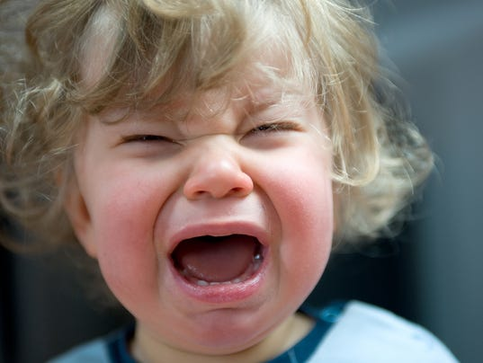 A blond haired toddler having a tantrum